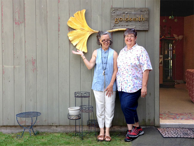 Raimie Weber and Deb Vandenbroucke enjoying a visit at her shop